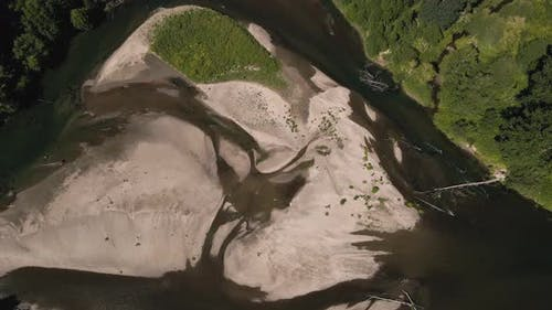 Natural Texture Patterns In Birds Eye View Aerial Of River Sand Island
