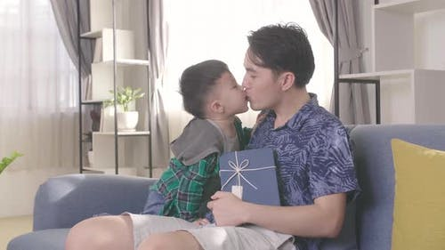 Father's Day, Son Kiss His Father Holding Gift