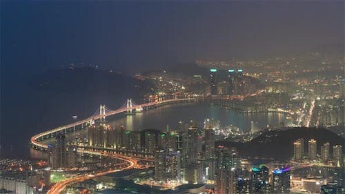The Gwangandaegyo or Diamond Bridge from day to night as seen from the hill