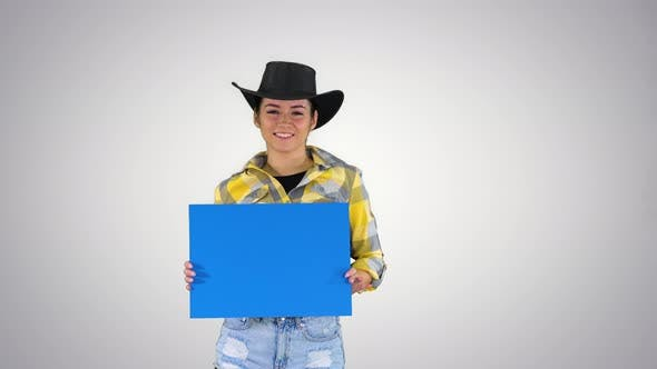 Thumbnail for Smiling Pretty Cowgirl Holding Empty Board and Dancing on Gradient Background.