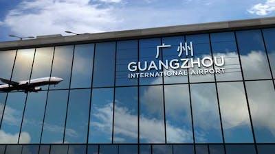 Airplane landing at Guangzhou China airport mirrored in terminal