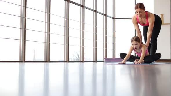 Mom and daughter do yoga, morning gymnastics, healthy lifestyle