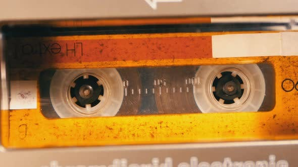 Thumbnail for Vintage Yellow Audio Cassette in the Tape Recorder Playing and Rotates