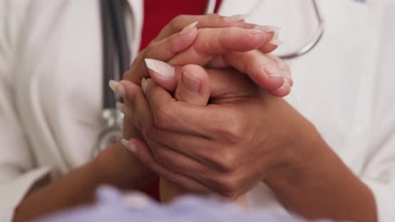 Thumbnail for Close up of doctor's hands holding patient's hand
