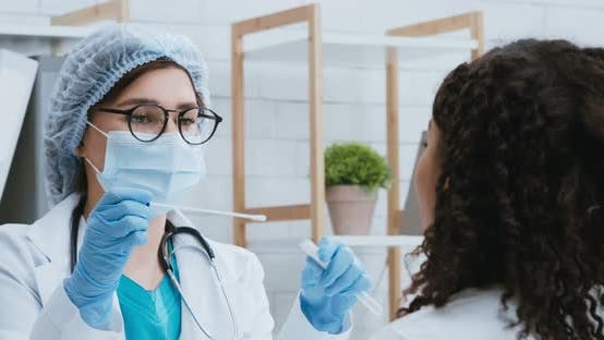 Doctor in Protective Mask Taking Pcr Test Sample From Black Woman with Coronavirus Symptoms
