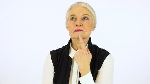 Thumbnail for An elderly woman thinks about something - white screen studio