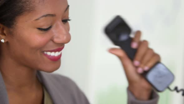 African American business woman talking on telephone