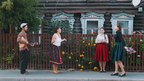 Thumbnail for Young Women Dancing on the Street in the Village By the Music