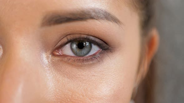 Closeup Beautiful Woman eye. Young blue eyed girl, macro shoot