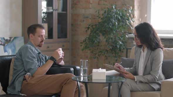Man with Mental Health Problems Talking to Therapist