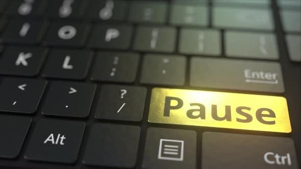 Thumbnail for Black Computer Keyboard and Gold Pause Key