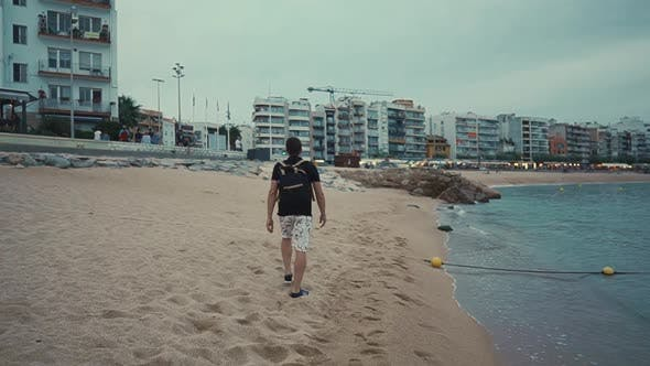 Thumbnail for Guy on a Lonely Walk on Beach.