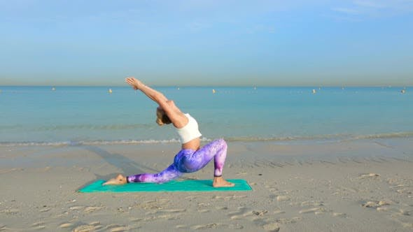 Thumbnail for Doing Yoga by the Sea on the Sand