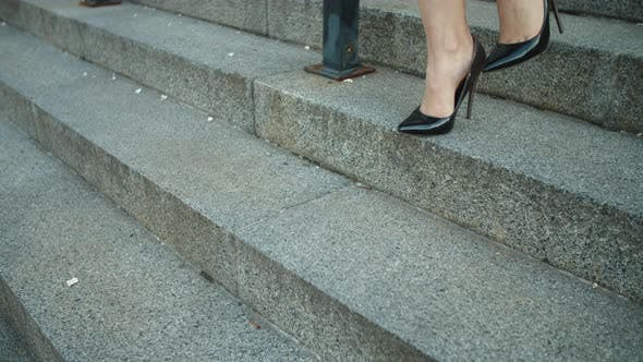 Thumbnail for Closeup Female Feet Going Downstairs in Shoes. Woman Walking in High Heel Shoes