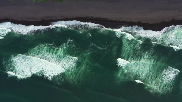 Aerial Top View of Beach with Black Sand
