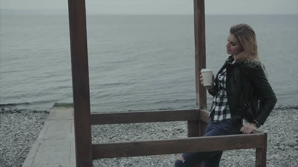 Close Up of Blond Woman Drinking Coffee and Looking To the Sea