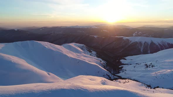 Cover Image for Flight Over the Snowy Mountains Illuminated By the Evening Sun