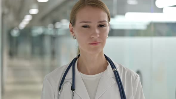 Thumbnail for Portrait of Disapproving Female Doctor Shaking Head, No Sign