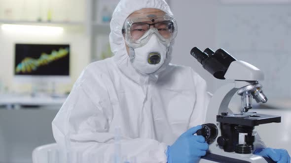 Asian Medical Scientist Posing in Laboratory