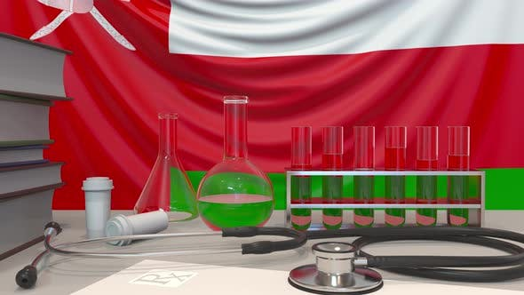 Clinic Laboratory Equipment on the Omani Flag Background