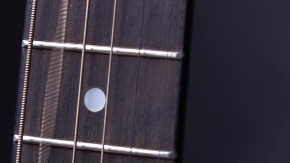 Cover Image for String of Acoustic Guitar, Second String, on Black, Close Up, Slow Motion