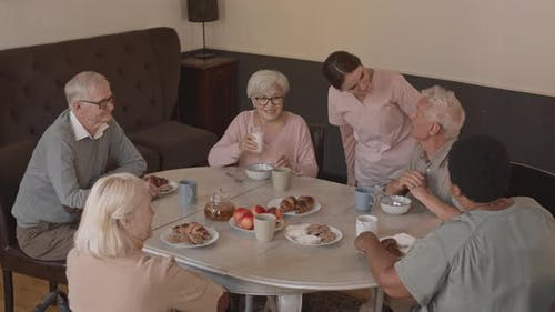 Senior People at Dining Table in Nursing Home