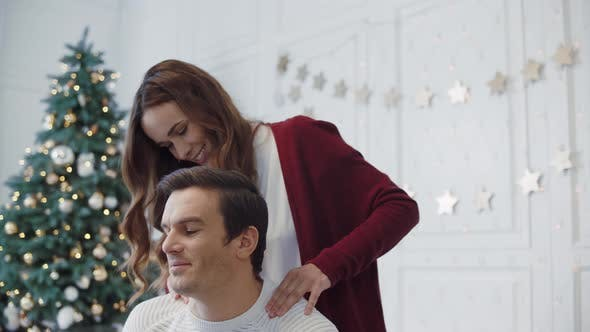 Thumbnail for Closeup Pretty Wife Massaging Husband Shoulders in Luxury House