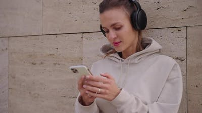 Urban Girl in Headphones with Cell