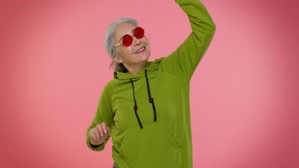 Senior Woman Listening Music Dancing Disco Fooling Around Having Fun Expressive Gesticulating Hands