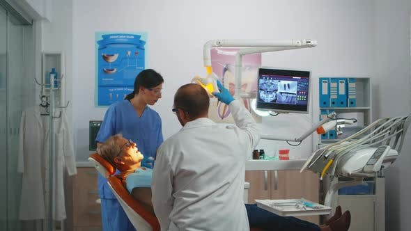 Professional Dentist Working with Gloves During Examination