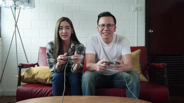 Thumbnail for Young play video game together