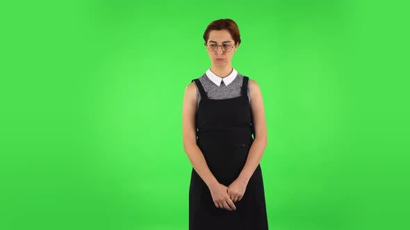 Thumbnail for Funny Girl in Round Glasses Is Very Offended and Looking Away. Green Screen