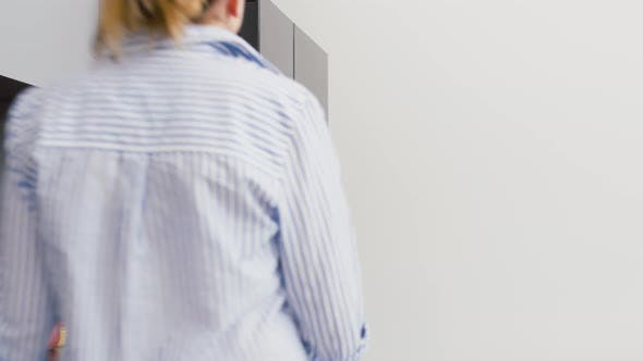Thumbnail for Woman Taking Food Container From Fridge at Kitchen