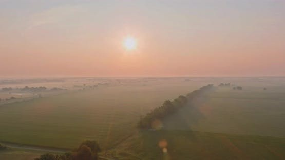 Foggy morning at scenic meadow with beautiful autumn misty sunrise landscape the dense fog