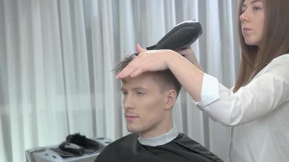 Female Barber Drying Hair