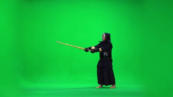 Cover Image for Masculine Kendo Warrior Practicing Martial Art with the Bamboo Bokken on Green Screen. Slow Motion