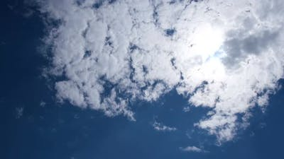 Blue Sky in Fluffy White Clouds