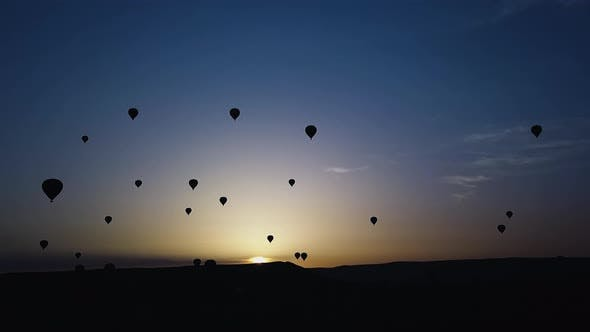 Hot Air Balloons Hover Over the Valley