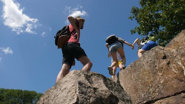 Thumbnail for Hikers Helping To Friends To Climb on Mountain Top