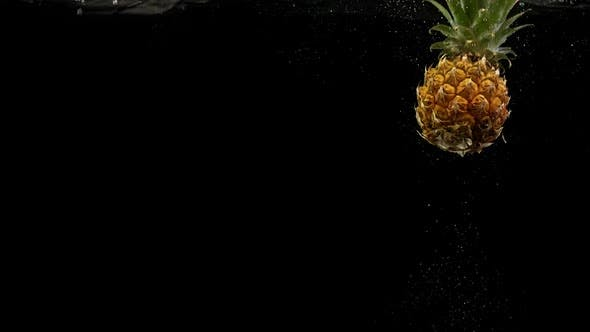 Thumbnail for Tropical Fruit Pineapple Under Water with Splash and Air Bubbles on Black Background