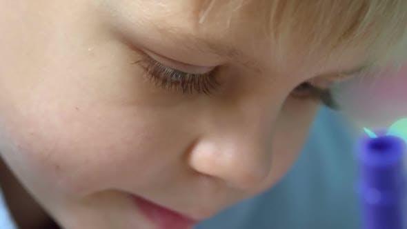 Little Kid Focused on Drawing
