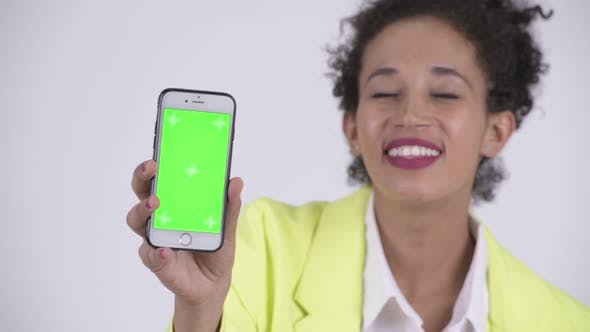 Cover Image for Face of Young Happy African Businesswoman Showing Phone