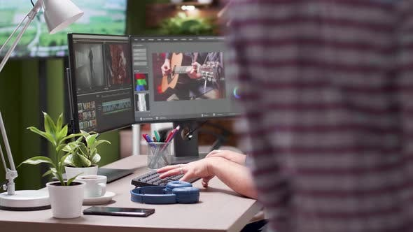 Thumbnail for Videographer Working in Busy Office