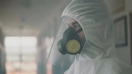 Worker wearing hazardous materialssuit