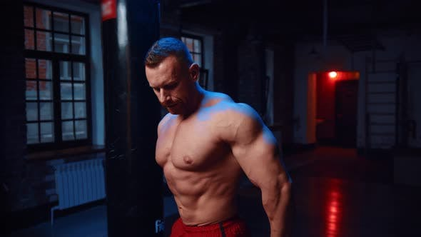 Thumbnail for Strong Man Standing in the Gym and Showing His Muscles