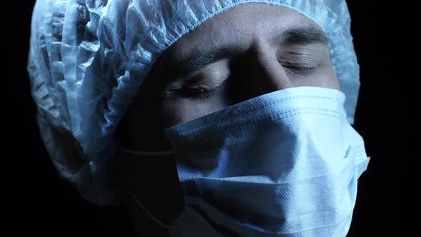 Thumbnail for Surgeon Prays in a Dark Room Before Surgery