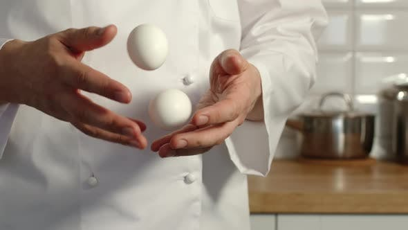 Thumbnail for Chief-Cooker Juggles A Chicken Eggs In A Kitchen