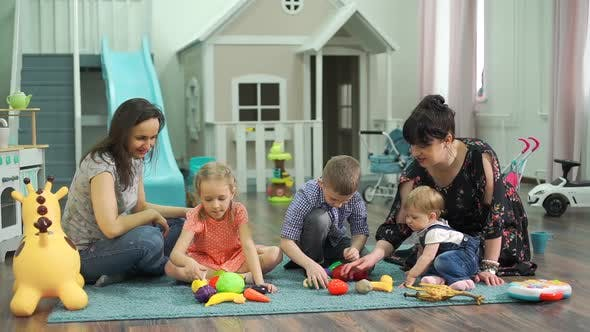 Teachers and Toddlers Playing at Kindergarten