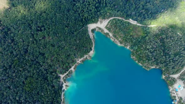 Thumbnail for Aerial View of a Blue Lake Surrounded By Forest.