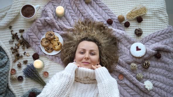 Thumbnail for Cheerful Young Female Wearing Knitted Sweater Lying On Bed